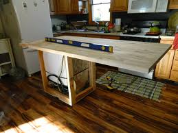 dirty hands beautiful life diy butcher block island with dishwasher i started the process of oiling the butcher block