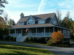 one country house plans with wrap around porch wrap around porch is a must this is my other option if i can t