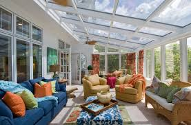 bright glass enclosed patio decor with blue leather sofa and