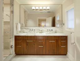bahtroom large bathroom mirror frames above wooden vanity plus