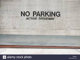 rolling garage doors residential no parking sign on a rolling garage door new york city new york
