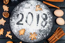 new year cookie cutters happy new year 2018 written on flour and christmas decorations