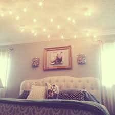 break all the rules and hang globe string lights above the bed