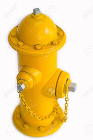 colors close to yellow miniature fire hydrant in the yellow color close up stock photo