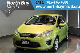 who owns mazda motor company pre owned 2012 ford fiesta se 4dr car in north bay u6097 north