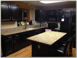 How To Stain Kitchen Cabinets by How To Restain Kitchen Cabinets Darker Gramp Us