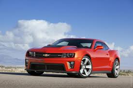 to own a new camaro zl1 burnt orange or black with black rims