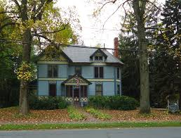 file amherst massachusetts house with trees and leaves in early