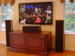 home theater wall stand wall mounted tv with tower speakers and a center speaker placed on