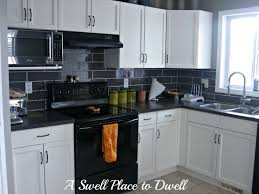 kitchen modern black kitchen cabinet desing with white