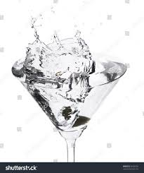 martini splash cocktail splash martini glass on white stock photo 36409102