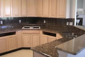 backsplash for kitchen with granite white oak cabinets with brown granite backsplash and countertops