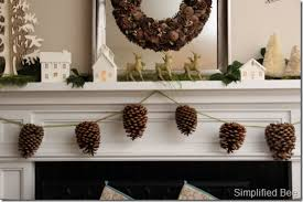 pinecone garland nature inspired christmas mantel simplified bee