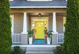 yellow front door beach style philadelphia with metal trellises