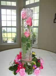 hurricane vases with flowers in water beautiful water beads for