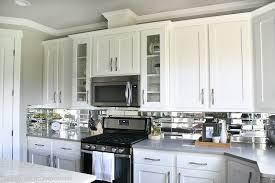 mirror backsplash in kitchen kitchen decor with white reveal mirrored kitchen cabinet