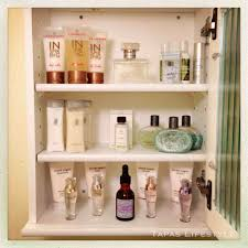 women bathroom with white medicine fancy lotions wall organizer