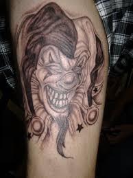 evil joker clown tattoo on leg