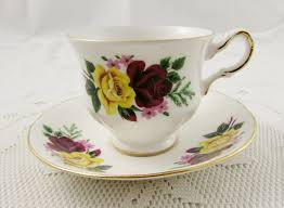 vintage queen anne tea cup and saucer with yellow and red rose