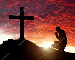 praying to a cross stock photo brianajackson 44080093