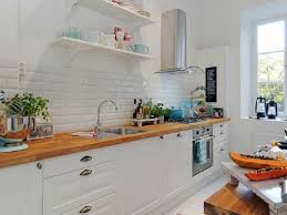 delightful kitchen design with wooden kitchen countertop and white