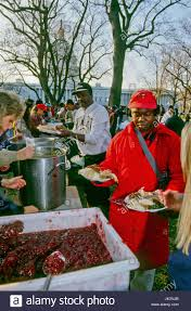 homeless are served thanksgiving dinner by members of the