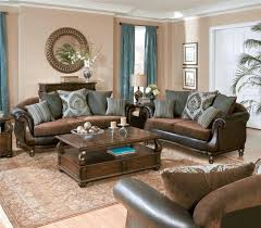 brown sofas blue pops and cream colored walls my living room