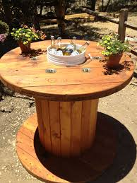 outdoor tables made out of wooden wire spools wooden spool table sanded and stained the spool cut a hole in the