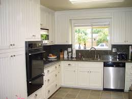 distressed kitchen cabinets pictures distressed cabinet beadboard childcarepartnerships org