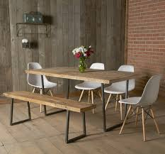 Cleaning A Wooden Dining Table by Reclaimed Wood Forms The Top Of This Dining Table And The