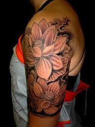 black and grey lotus flowers tattoo on left half sleeve