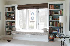 simple bay window decor with stripped seat and small white shelves