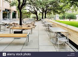 outdoor sitting area near university building with small tables