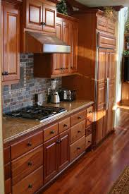 what backsplash looks with cherry cabinets cherry kitchen with slate backsplash american traditional