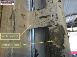 garage door bottom bracket why my garage door makes loud noise every time i use it