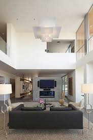 Decorating Ideas For High Ceiling Living Rooms Minimalist Living Room With High Ceiling Design Ideas High