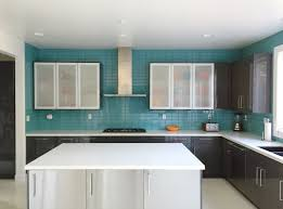 kitchen appealing light blue glass backsplash with stainless appealing light blue glass backsplash with stainless steel range hood and double floating shelves plus white kitchen island for modern kitchen design ideas