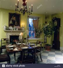 Lime Green Dining Room Chandelier Above Antique Table And Chairs In Lime Green Dining