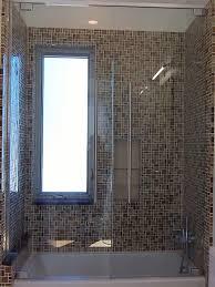 frameless steam shower enclosure mirrored medicine cabinet clear
