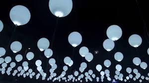large white balloons an aerial kinetic sculpture with 256 helium balloons embedded with