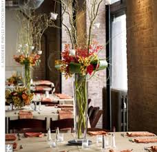Tall Glass Vase Centerpiece Ideas The Couple Placed Tall Glass Vases Filled With Orange Gold And