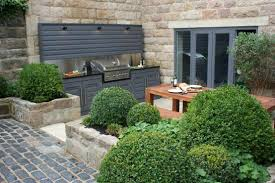 brick stone walll exterior house woode floor in terrace chair