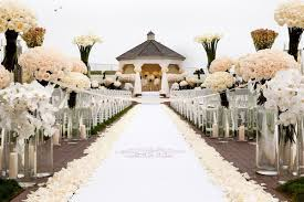 wedding aisle runners oceanfront ceremony opulent pink and metallic reception inside