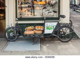 cheese delivery fashioned bicycle for delivery of cheeses outside cheese shop