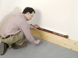how to fix cabinet bottom installing garage cabinets