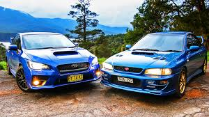 blue subaru gold rims subaru wrx sti old v new comparison 2015 sedan v 1999 two door