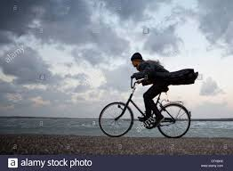 cycling wind the netherlands kerland woman cycling against the stormy wind