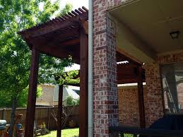 backyard arbor pergola among trees in allen texas hundt patio