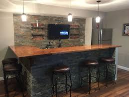 Basement Bar Countertop Ideas Man Cave Basement Bar Ledge Stone And Butcher Block Bar