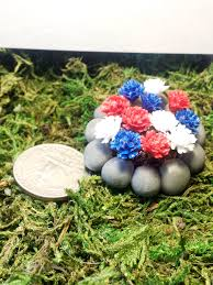 miniature round rock flower bed red white and blue flowers images